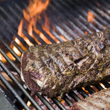 Meat on barbecue. Details of meat cooking on barbecue grill Stock Photos