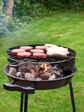 Meat on barbecue Stock Images