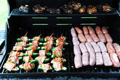 Meat barbecue. Sausage, bacon, chicken, beef for barbecue Royalty Free Stock Photo