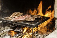 Meat on barbecue Stock Photos