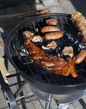 Meat on the bbq. Meat and sausages on the bbq royalty free stock photography