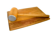 Meat beater. And wooden plank stock image