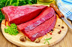 Meat of a beef on the board with nutmeg Royalty Free Stock Photos