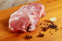 Meat. Beef, veal. Fresh raw tenderloin, piece without bone. For frying grilling barbecue. Cut into steaks,. Whole. cutting board, spices, Top view Fresh Stock Images