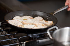 Meat Being Fried In Cooking Pan Stock Photography