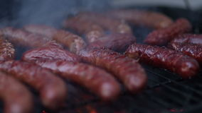 Meat being grilled on barbeque stock footage