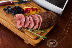 Meat with berries Stock Image
