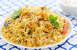 Meat Biryani. Biryani, biriani, or beriani is a set of rice-based foods made with spices, rice usually basmati and meat, fish, eggs,chicken or vegetables like stock photography