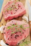 Meat with black pepper, rosemary Royalty Free Stock Photography