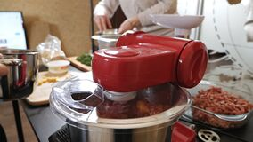 Meat in a blender. The process of grinding meat and potatoes. Use a blender to grind minced meat products