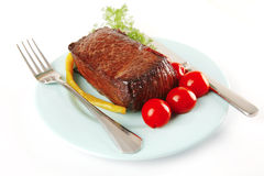 Meat block on blue dish Stock Photos