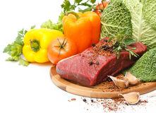 Meat on board with vegetables Royalty Free Stock Image