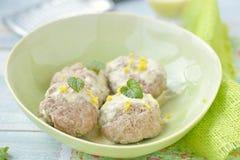 Meat bolls with lemon sauce Stock Image