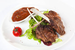 Meat on the bone with red sauce Stock Photos