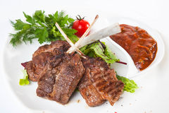 Meat on the bone with red sauce Stock Photography