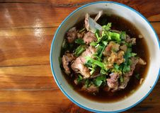 Meat bone soup with vegetable. Asian pork rib broth royalty free stock images