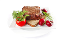 Meat on bread Royalty Free Stock Images