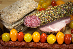 Meat with bread and colored tomatoes. Meat with bread and tomatoes on wooden table royalty free stock images