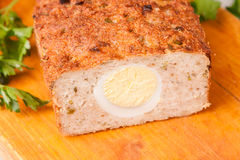 Meat bread from rissole turkey on wooden board Stock Images