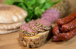 Meat with bread and sausages. Meat with bread on wooden table stock image