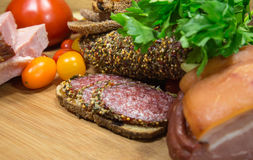 Meat with bread and tomatoes. On wooden table royalty free stock photography