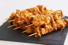 Meat brochettes on a slate tray. Meat brochettes on a black slate tray Stock Image