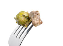 Meat and brussels sprouts on fork Stock Images
