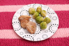 Meat with Brussels sprouts Stock Photos