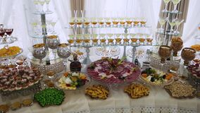 Meat buffet with sausages, cheeses, sandwiches, nuts, chips and alcohol