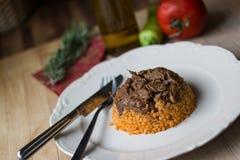 Meat with bulgur rice / Organic food. Royalty Free Stock Photo
