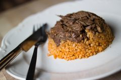 Meat with bulgur rice / Organic food. Stock Photography