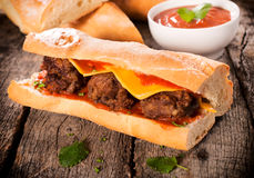 Meat in bun. Bread stuffed with melted cheese and meat balls.Selective focus on meat ball in the middle Royalty Free Stock Photo