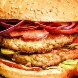 Meat Burger with beef cutlet and fresh vegetables macro close-up stock images