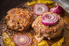 Meat burger fries in a pan. Two meat burger fries in a pan Stock Images