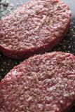 Meat for burgers, grilling, barbecue, bbq. Fresh, spicy, uncooked, delicious beef for hamburgers on dark background with. Copy space closeup Royalty Free Stock Photos