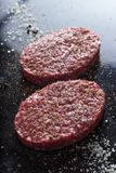 Meat for burgers, grilling, barbecue, bbq. Fresh, spicy, uncooked, delicious beef for hamburgers on dark background with. Copy space closeup Stock Image