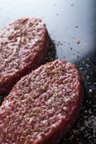 Meat for burgers, grilling, barbecue, bbq. Fresh, spicy, uncooked, delicious beef for hamburgers on dark background with. Copy space closeup Stock Images