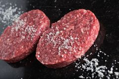 Meat for burgers, grilling, barbecue, bbq. Fresh, spicy, uncooked, delicious beef for hamburgers on dark background with. Copy space closeup Stock Photos