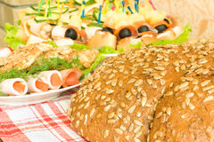 Meat, canape and Bread with seeds on table Royalty Free Stock Photo