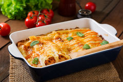 Meat cannelloni sauce bechamel. Meat cannelloni sauce bechamel on table stock photography