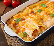 Meat cannelloni sauce bechamel. Meat cannelloni sauce bechamel on table stock image