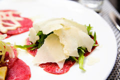 Meat Carpaccio with Parmesan Cheese, sauce and mushrooms stock images