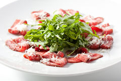 Meat Carpaccio with Rocket Salad Royalty Free Stock Photography