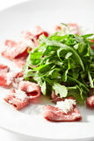 Meat Carpaccio with Rocket Salad Stock Images