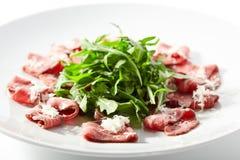 Meat Carpaccio with Rocket Salad Stock Image