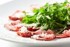 Meat Carpaccio with Rocket Salad Stock Photo