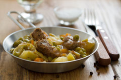 Meat with carrot, peas Stock Images