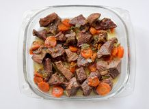Meat and carrots. Beef meat, carrots and vegetables royalty free stock photo