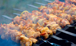 Meat on a charcoal grill. Smoke meat on a charcoal grill Stock Photography