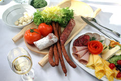 Meat and cheese. With fresh tomatoes and salad Royalty Free Stock Images